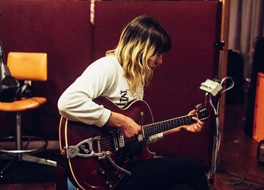 """Cassie of Vivian Girls working on their upcoming record, """"We're Coming Out Swinging."""" Photo credit: Julia Brokaw*"""